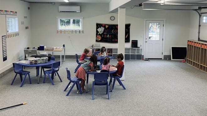 Several children, including York second-grader Shayla Ohlson, explore the newly established alternative classroom on Sunday, Aug. 16, 2020, that several families banded together to establish in Ohlson's family garage. Nine second-graders will receive instruction from a privately hired teacher in the space this school year, parents said.