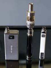 Electronic cigarettes are displayed for sale.