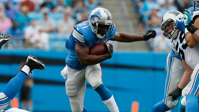 Detroit Lions running back Reggie Bush breaks through a large hole on a rush against the Carolina Panthers in Charlotte, North Carolina on September 14, 2014. Bush was cut by the Lions today.