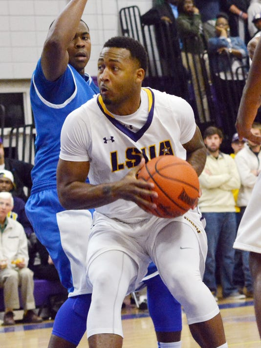 ANI LSUA Basketball LSUA's Darryl Milburn (5, front) looks to pass against Dillard Wednesday, Nov. 13, 2014.-Melinda Martinez/mmartinez@thetowntalk.com, The Town Talk, Gannett