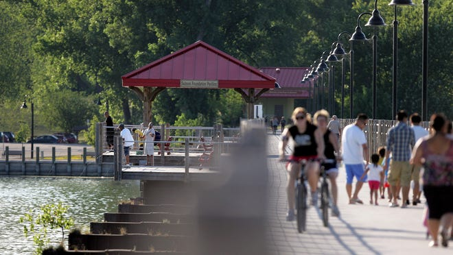 Residents fish, bike, walk and run on the Fox Cities Trestle Trail across Little Lake Butte des Morts.