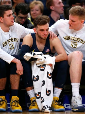 Teammates console Marquette guard Andrew Rowsey during the waning seconds of his final Big East game.