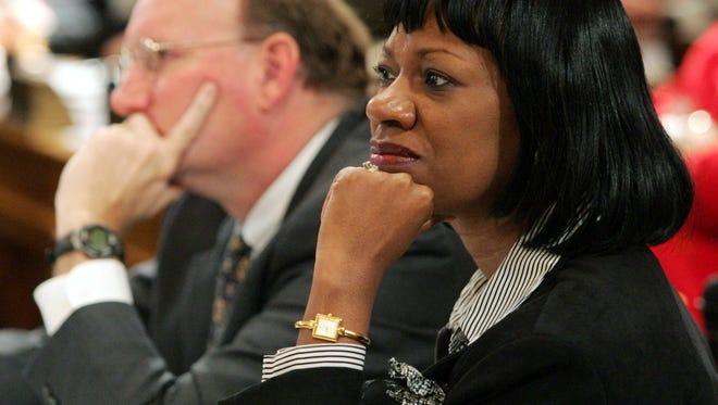 In this Wednesday, Feb. 9, 2005 file photo, Minority Whip Carolyn Fleming Hugley, D-Columbus, right, and Minority Leader DuBose Porter, D-Dublin, left, attend a meeting at the Capitol in Atlanta. In 2017, Georgia Republicans sought to change the boundaries of several state House districts, including a couple won by Republicans by single-digit margins last November. Some of the proposed shifts sought to move heavily black precincts _ where voters overwhelmingly support Democrats _ from Republican-held districts into ones occupied by Democrats. Although the bill passed the House, it died in the Senate. Hugley criticized it as gerrymandering intended to create safer Republican seats. (AP Photo/Ric Feld, File)