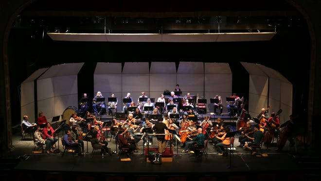 Members of the Mansfield Symphony Orchestra rehearse at the Renaissance Theatre.
