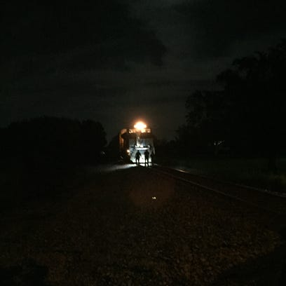 Richmond Police Department and railroad officials survey
