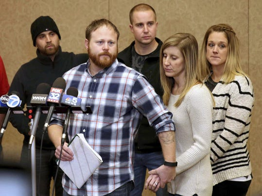 Family spokesman David Boyd and others hold a news conference