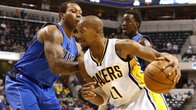 """Indiana Pacers' David West, shown here trying to get around Dallas Mavericks' Greg Smith, suffered """"a good sprain"""" in the Oct. 18 preseason game that has the power forward out for the rest of the Pacers' preseason schedule."""