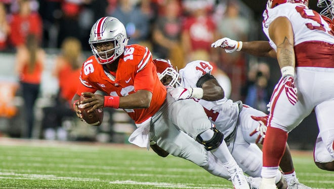 Ohio State quarterback J.T. Barrett is sacked by Oklahoma linebacker Emmanuel Beal.