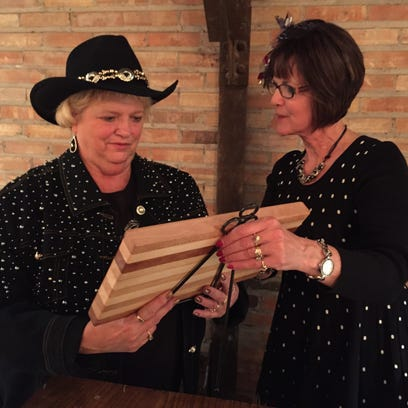 Sue Logsdon, president of the Chamber, gives  a butcher-block