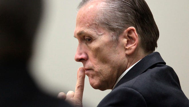 This Nov. 7, 2013, file photo, shows Martin MacNeill listening to Gypsy Willis testify during his murder trial in 4th District Court in Provo, Utah.