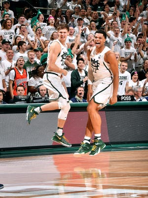 Matt McQuaid and Miles Bridges leap after McQuaid drained a 3-pointer on a feed from Bridges in the second half.