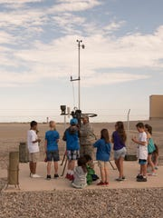 Master Sgt. Patricia Hurdle, the detachment chief for Det. 4, 2nd Weather Squadron, shows the Youth and Teen Development class outside of the Bob V. Schaffer Building on July 25 on Holloman Air Force Base, N.M. The class learned about the cloud measuring equipment during a tour, which highlighted careers in aviation and Science, Technology, Engineering and Mathmatics.