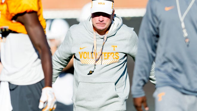 Tennessee Head Coach Butch Jones walks on the field during Tennessee fall football practice at Anderson Training Facility in Knoxville, Tennessee on Tuesday, October 31, 2017.
