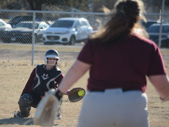 McMurry catcher Kayla Otis, an Abilene High graduate, catches a pitch from Cheyenne West during a practice Friday, Jan. 19, 2018, at Red Bud Park.