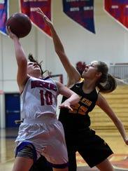 Galena's Zoe Conatser attempts a block on Reno's Jill