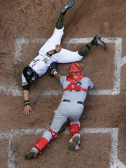 Tyler Saladino  is tagged out at home by Cardinals