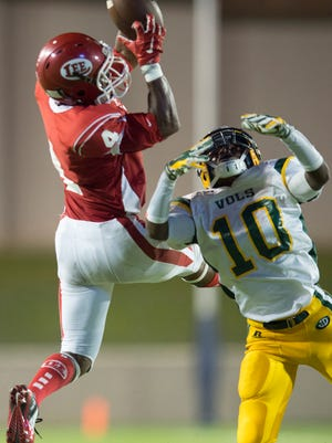 Lee's Jonah Garrison (4) catches a pass over Jeff Davis' Dequarius Thornton (10) during the game between Lee High and Jeff Davis High on Thursday, Sept. 17, 2015, at the Cramton Bowl in Montgomery, Ala.