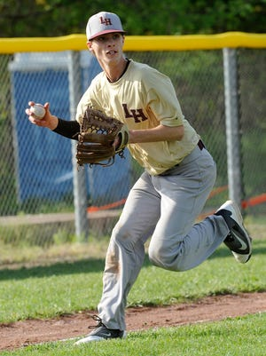 Licking Heights third baseman Cameron Moeller looks to make a throw to first during a game against Johnstown on May 5.