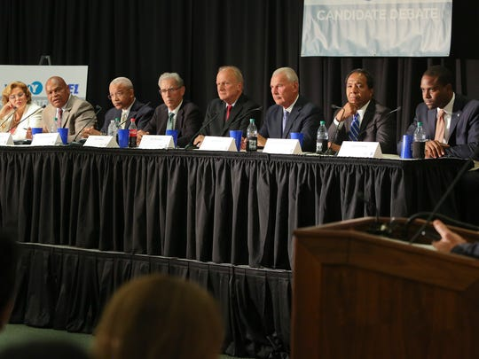 Wilmington mayor candidates (from left) Maria Cabrera, Theo Gregory, Norman Griffiths, Kevin Kelley, Bob Marshall, Mike Purzycki, Mayor Dennis P. Williams and Eugene Young debate Aug. 17. The crowded field has made it difficult for any candidate to become a clear leader in the Sept. 13 primary.