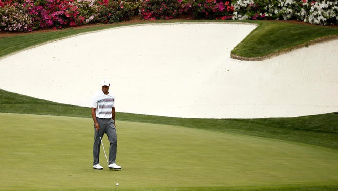 Tiger Woods prepares to putt on the 13th green during the first round of the Masters at Augusta National.