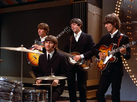 The Beatles prepare before a 1966 performance in a TV studio in London.