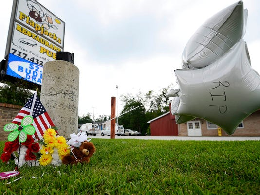 A makeshift memorial in front of Flapjacks Restaurant and Pub in Dillsburg. A team will be in the area to speak with civilians who witnessed the recent murder-suicide.