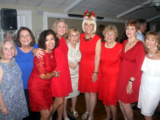 Spreading good cheer are Becca Scarborough, Donna Reiley, Marge Superits, Betsy Wohltman, Madeline Moore, Susie Walsh, Mary Ann Cassidy, Pam Clune and Sandi Friend.
