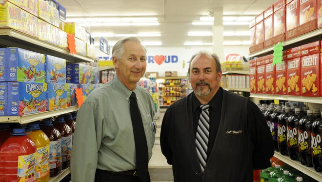 Jim and Mike Lehman operate the Lil' Bear in Newark. Jim is the store owner and Mike the manager.