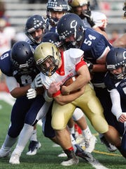 Mount Olive running back Anthony DiJoseph continues