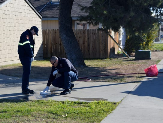 Tulare firefighters clean up blood on the driveway