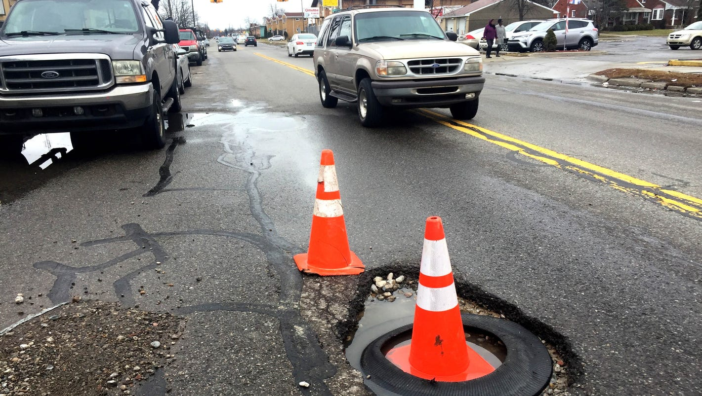 Does your body ache from hitting potholes? 5 reasons Michigan has lousy roads