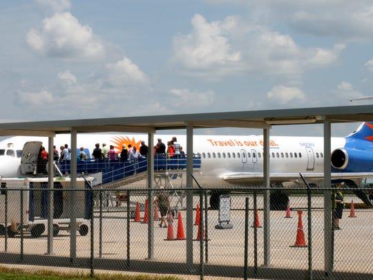 Passengers board Allegiant Air flight from Punta Gorda to Toledo, Ohio.