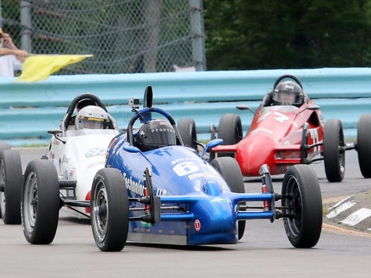 Jonathon Weisheit, in the No. 61 JK Technologies XP, leads a tight pack of Formula Vees in Turn 9 during the SCCA Majors Tour Group 3 race at Watkins Glen International Saturday.