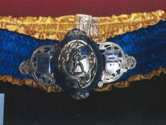 This is photo of Carmen Basilio's belt for winning