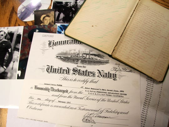 Foster has held on to many of his photos and documents from his time in World War II.