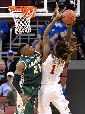 UAB's Tosin Mehinti, left attempts to block the shot of Iowa State's Jameel McKay during the first half of a second round game in the NCAA college basketball tournament in Louisville, Ky., Thursday, March 19, 2015. (AP Photo/Timothy D. Easley)