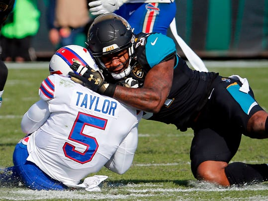 "FILE - In this Jan. 7, 2018, file photo, Jacksonville Jaguars defensive end Yannick Ngakoue, right, draws a penalty by hitting Buffalo Bills quarterback Tyrod Taylor (5) with helmet-to-helmet contact in the first half of an NFL wild-card playoff football game, in Jacksonville, Fla. Bob Costas isn't backing down on his belief that the NFL faces a day of reckoning on the issue of brain injuries, and talks about the one event he wishes he had been able to broadcast on the ""AP Sports Weekly"" podcast. The NBC and MLB announcer joins co-hosts Jim Litke and Tim Dahlberg to talk about a variety of issues, including the Olympics and how the growing use of analytics has made baseball into a different game than he watched growing up.(AP Photo/Stephen B. Morton, File)"