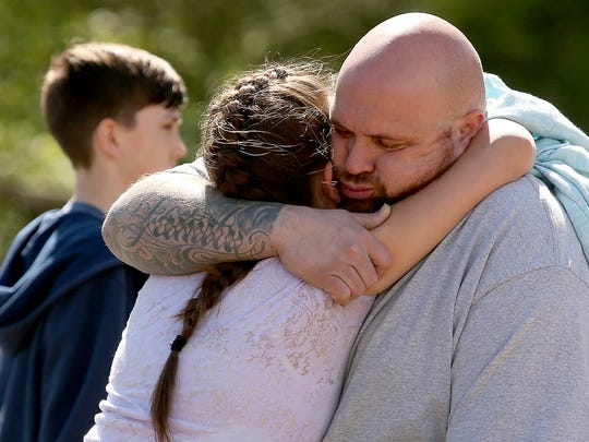 Students are reunited with loved ones Wednesday at the Theler Center.