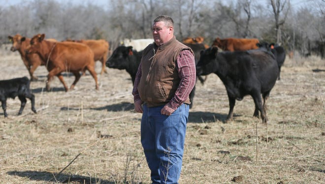 This March 10, 2017 photo shows Derek Sawyer, who farms and ranches near McPherson, Kan. He says farmers can't weather much more of the economic downturn that has hit the agricultural industry. (Travis Heying/The Wichita Eagle via AP)