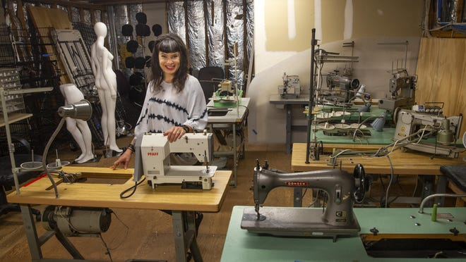 Mitra Gruwell stands with some of her industrial sewing machines in Viking Sewing, Vacuum, Spa and Stove on West Sixth Avenue. Gruwell is opening a new business called Discard Upcycling, and she's partnering with Viking to create a maker hub for sewists in Eugene. [Chris Pietsch/The Register-Guard] - registerguard.com