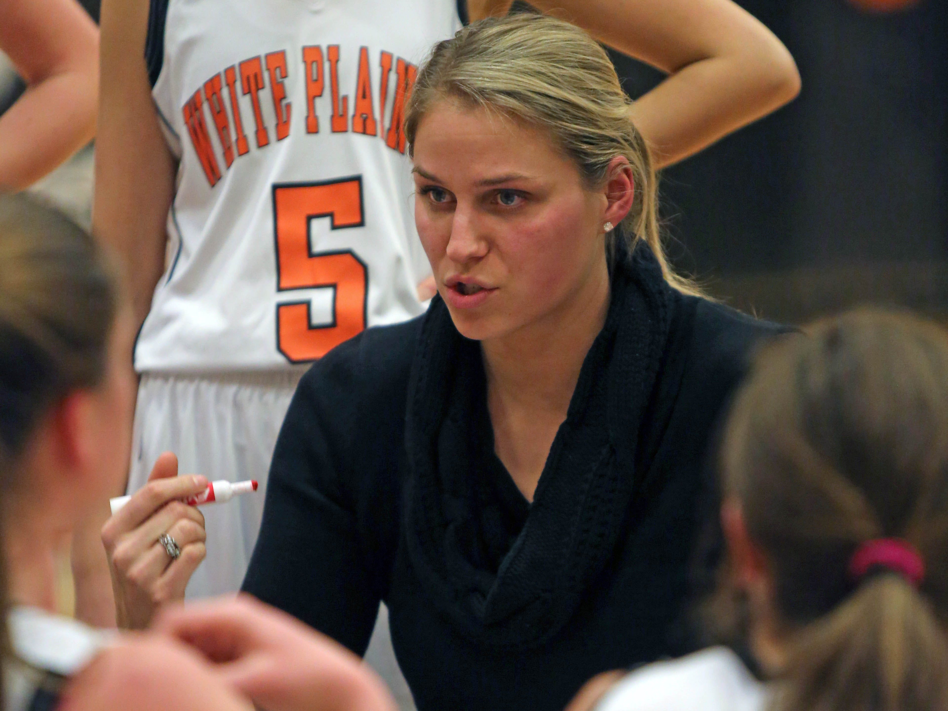 White Plains coach Tara Flaherty talks to her team during a time out during girls basketball game against Scarsdale at White Plains High School on Jan. 14, 2015. Scarsdale defeated White Plains 49-30.