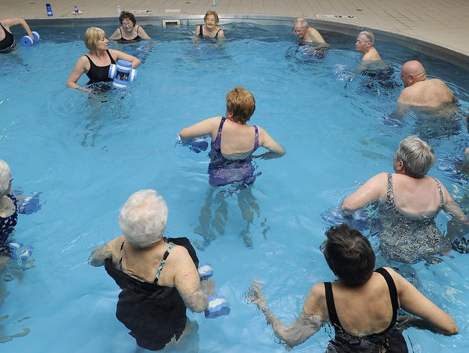 Apartment residents take part in water aerobics at Royal Oaks Apartments in Sioux Falls, S.D. Thursday, April 24, 2014.