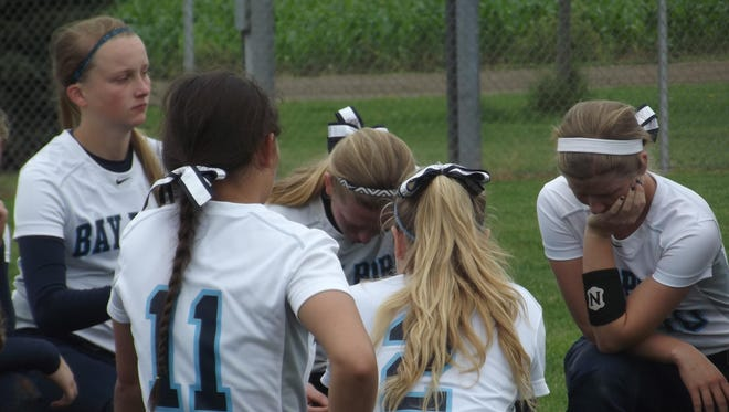 Bay Port softball players huddle following Saturday's 10-0 loss to Westosha Central in a WIAA Division 1 state semifinal game at Verona's Country View Elementary School.