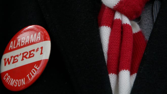 An Alabama football fan wears a button proclaiming their national championship, Saturday, Jan. 23, 2016, in Tuscaloosa, Ala. Alabama fans turned out by the thousands to celebrate the Crimson Tide's fourth national championship in seven years. (AP Photo/Hal Yeager)