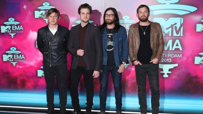 From left, Matthew Followill, Jared Followill, Nathan Followill and Caleb Followill of the band Kings of Leon pose for photographers upon arrival at the 2013 MTV Europe Music Awards, in Amsterdam, Netherlands on Nov. 10, 2013.