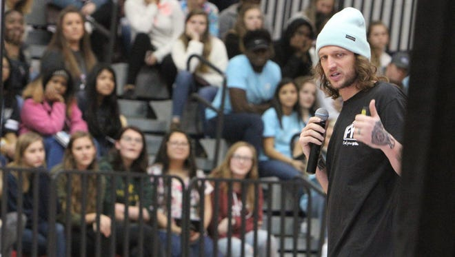 Mike Smith talks to a crowd of students at Powdersville High School.