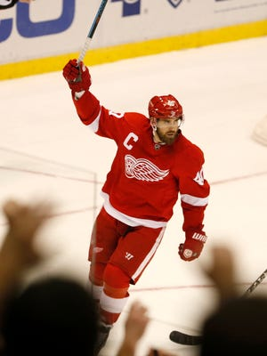 Red Wings fans applaud Henrik Zetterberg  in the third period after his third goal of the game and a natural hat trick for a 6-4 lead over the Buffalo Sabres on Sunday in Detroit.