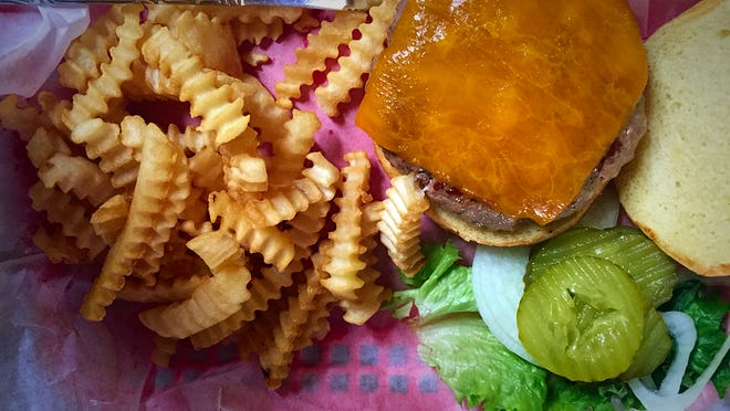 The Cheeseburger ($9.25) is a 6 ounce patty of 93 percent lean burger topped with cheddar cheese and served with lettuce, onion and pickles. Tomatoes are available upon request.