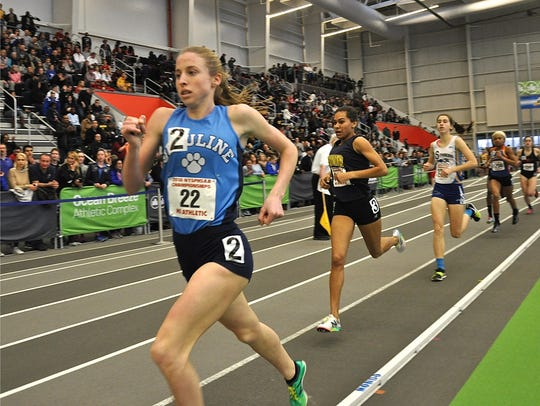 Ursuline's Lily Flynn runs to win in girls 1, 000 at