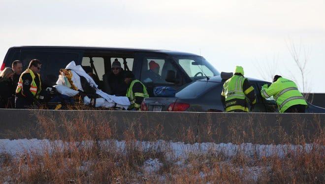 Emergency workers on scene of crash on I-490, near University Avenue.